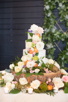 Wedding Cake Covered in Flowers | Legendary Events